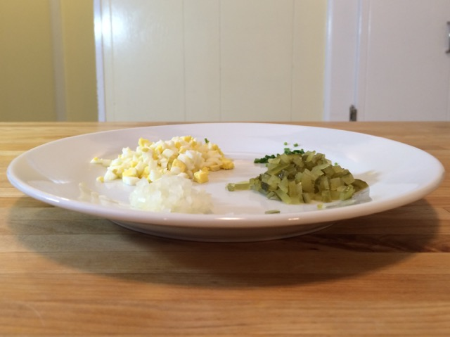 Chopped egg, sweet pickle, chives, and parsely