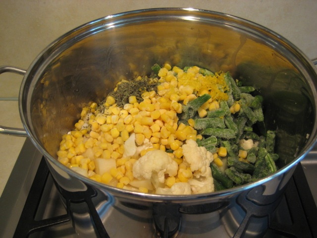 Herbs, frozen corn and beans added