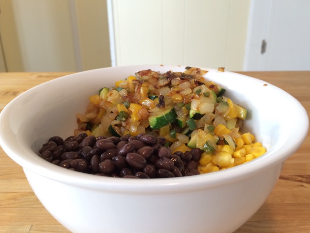 Beans, corn, and cooked vegetables in a bowl
